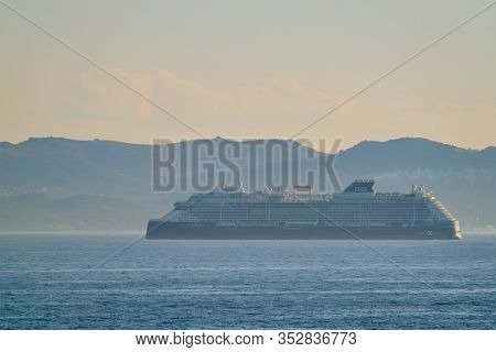 AEGEAM SEA, GREECE - MAY 30, 2019: Cruise liner ship Edge of Celebrity lines in Mediterranean sea. Aegean sea, Greece. Sea view landscape near the Cyclades islands