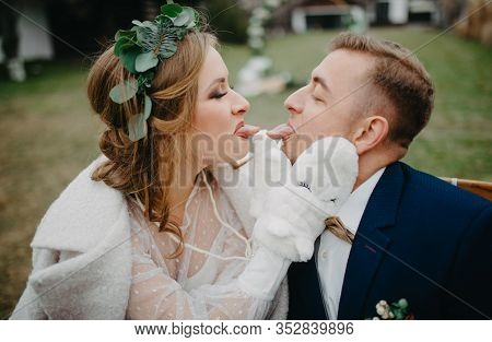 Newlyweds Have A Fun, Frolic And Show Each Other Tongue. Closeup.