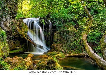 Long Exposure Of The Beautiful La Vaioaga Waterfall With Green Moss, Beusnita, Cheile Nerei National
