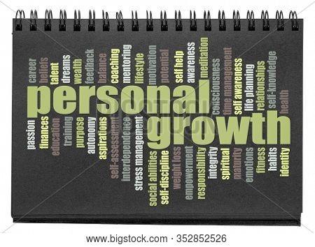 personal growth word cloud on a balck paper spiral sketchbook, self improvement and development concept