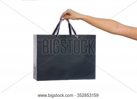 Paper Craft Bag, Eco Packaging In A Female Hand, Isolated On White Background, With Place For Text.
