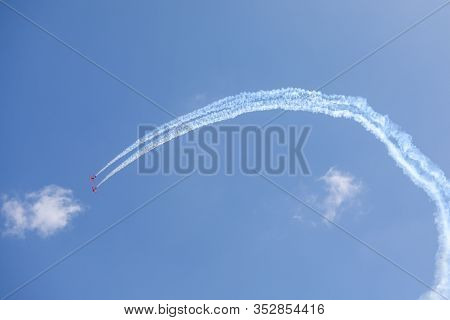 Plane Doing Acrobatic Formation In The Blue Sky. Airplanes On Airshow. California
