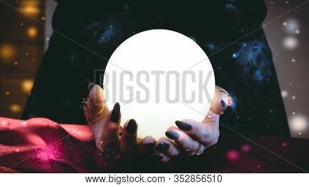 Fortuneteller's Hands With A Crystal Ball. Clairvoyance