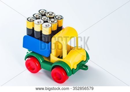 Toy Truck With Full Body Of Aa Batteries. Energy Need Concept. Electric Truck