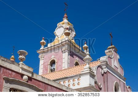 Light Bordeaux Color Of The Walls, White Details. Palace Estoi Built In Neo Rococo Style. View On It