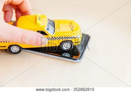 Smartphone Application Of Taxi Service For Online Searching Calling And Booking Cab Concept. Hand Ho