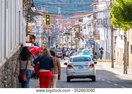 SUCRE / BOLIVIA - APRIL 10, 2018: Street in the city of Sucre in Bolivia filled with bright sunny light