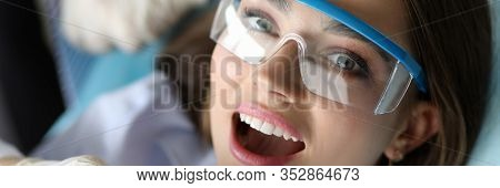 Close-up Of Beautiful Female On Annual Doctor Appointment. Wonderful Woman Visiting Examination With