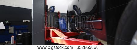 Close-up Of Red Pillaring Stand Used For Automobiles And Sportcars Examinations And Lifting Heavy Ma
