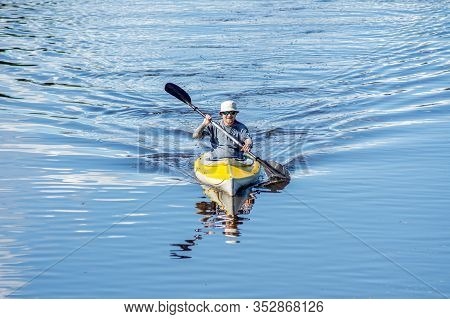 Ryazan, Russia - 06.07.2019: Front View Man With Tatoo Kayaking On Blue River