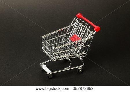 Empty Toy Shopping Cart Ocn Grey Background.