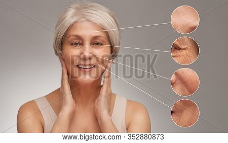 Portrait of beautiful senior woman. Close ups of wrinkles and skin imperfection on the face. Aging process concept.
