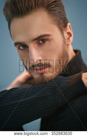 Portrait of a handsome young man. Men's beauty. Studio shot.