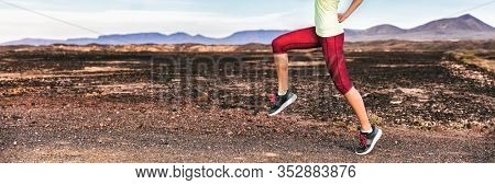 High knees cardio exercise legs workout performed at fast pace to burn fat training outside on trail run running in mountain nature landscape banner background. Woman runner working out outdoor.