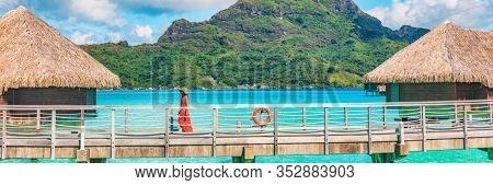 Tahiti luxury resort vacation in Bora Bora island, French Polynesia summer travel header landscape. Woman tourist walking at hotel, paradise destination panoramic.