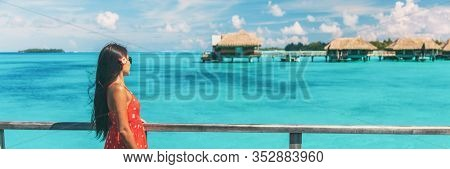 luxury resort honeymoon vacation cruise destination in Bora Bora island, Tahiti, French Polynesia. Woman walking on idyllic beach landscape header banner.