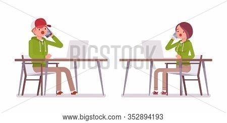 Young Man, Woman Sitting At Desk Working With Laptop, Phone Talking, Wearing Hoodie Jacket. Cute Sma