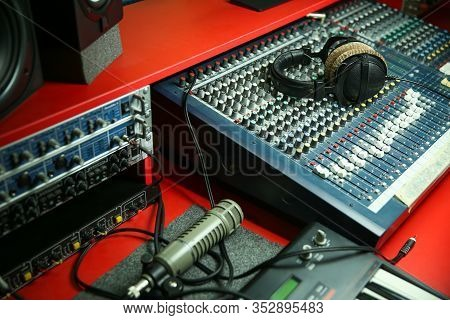 Sound Recording Equipment And Headphones On A Table In A Music Recording Studio