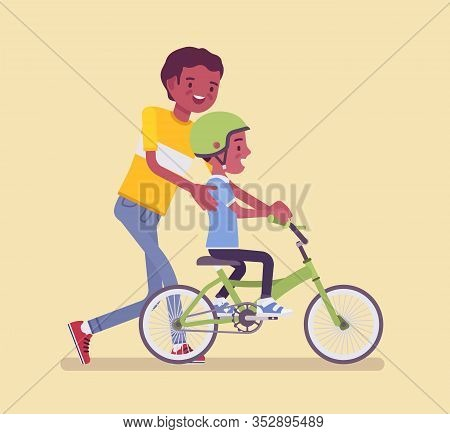 Father Guiding Son Riding Safely A Bicycle. Boy Learning To Ride A First Pedal Bike, Beginning Rider