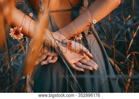 Close Up Of Young And Tender Woman Hands Crossed Behind The Back