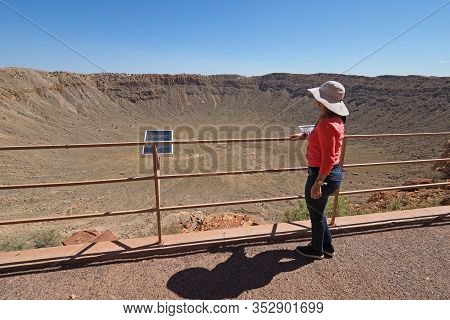 Meteor Crater, Winslow, Arizona - May 22, 2016 - Woman Gazes At Meteor Crater On Clear Cloudless Sum