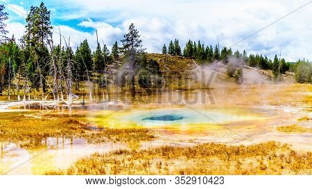The Turquoise Water Of The Culvert Geyser In The Upper Geyser Basin Along The Continental Divide Tra