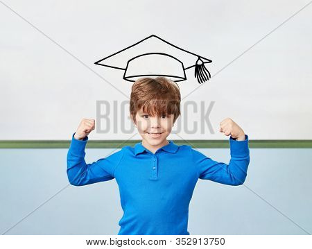 Child in school cheers with clenched fists in front of a mortarboard on the whiteboard