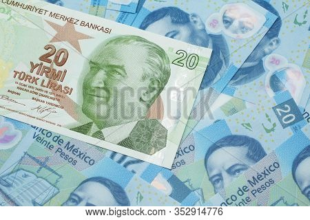 A Close Up Image Of A Green Twenty Turkish Lira Bank Note On A Background Of Mexican Twenty Peso Ban