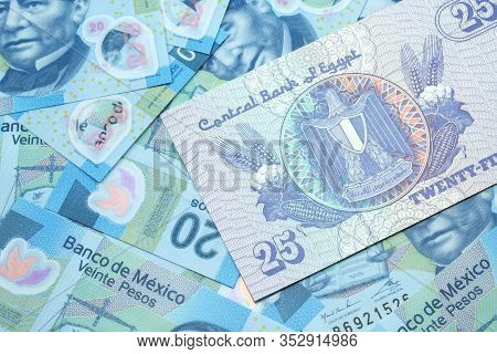 A Close Up Image Of An Egyptian Twenty Five Pisatres Note With Mexican Twenty Peso Bank Notes In Mac