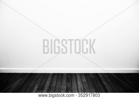 A white room with monotone floor. Black and white room.