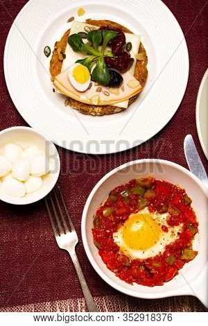 A Dish Of The Fried Egg With The Stewed Peppers. Top View.