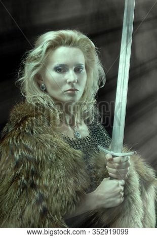 Valkyrie. Viking Fashioned Girl With Sword Portrait