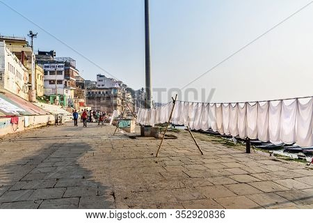 Varanasi, India - March 18, 2019: Laundry Drying On Rope On Ghat In Sunny Day At Varanasi