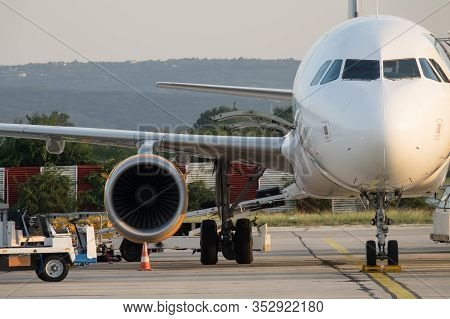 Airplane Is Serviced By The Ground Crew. Airplane Getting Prepared For Take Off