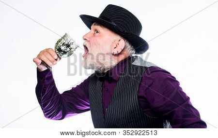 Exotic Food. Cocktail With Real Spiders. Alcohol Drink And Bar. Bearded Old Guy Hold Wineglass With