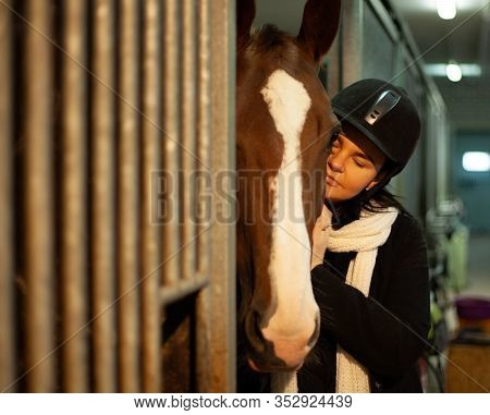 Women Jockey With A Horse, Horseback Training On Manege, Lesson For Jockey In Equestrian School Or C