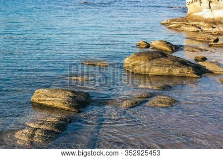 Nature Calm Background Scenic View Stone Rocky Shore Line And Peaceful Reservoir Water Surface Copy