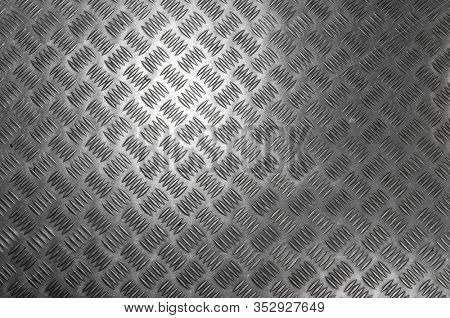 Metal diamond pattern non-skid gray wrap around texture seamless tile. Pattern style of steel floor for background. Pattern style of aluminum floor background and metallic texture