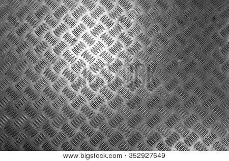 Metal diamond pattern non-skid gray wrap around texture seamless tile. Pattern style of steel floor for background. Pattern style of aluminum floor background and metallic texture