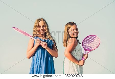 Energetic Children. Happy And Cheerful. Sporty Game Playing. Summer Outdoor Games. Play Tennis. Chil
