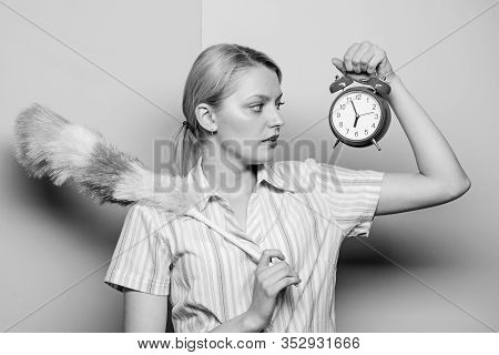 Perfectionism Concept. Woman Hold Dust Brush Alarm Clock. Everything Must Be Perfect. Girl Perfectio