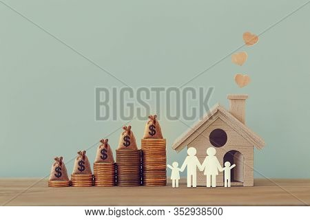 Mini House And Heart, Family Members, Us Money Bags On Rows Of Rising Coins On Table. Family Tax Ben