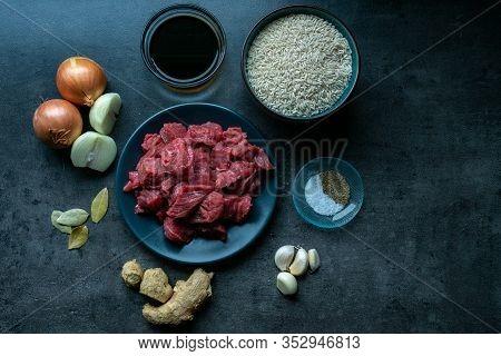 Top View Of Food Ingredients, With Meat, Ingredients And Beef On Dark Floor, Indonesian Ingredients.