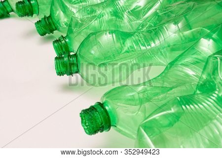 Sorted Plastic Green Bottle For Recycling And Waste Sorting And White Background With Copy Space For