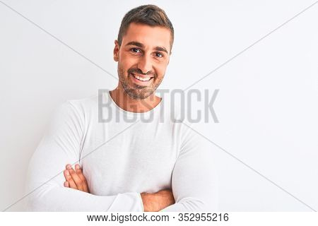 Young handsome man wearing white shirt over isolated background happy face smiling with crossed arms looking at the camera. Positive person.