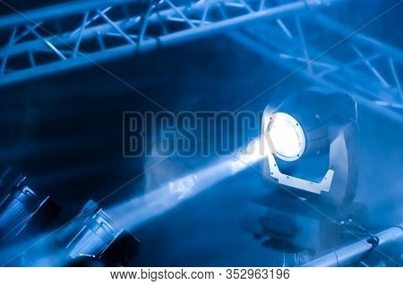 Blue Toned Spotlight On A Theatre Stage Lighting Rig