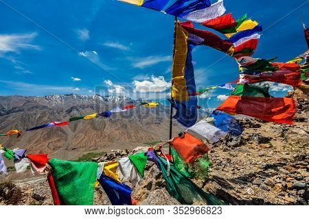 Buddhism prayer flags lungta with Buddhist mantra written on them in Spiti Valley in Himalayas mountains, Himachal Pradesh, India