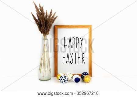 Frame With Happy Easter Phrase, Modern Golden, Blue And White Easter Eggs, Trendy Dry Flowers In Gla