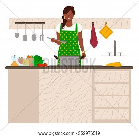 Woman Stand By Table In Kitchen. Lady Boil Soup In Pan. Kitchenware And Vegetables On Desk. Ingredie