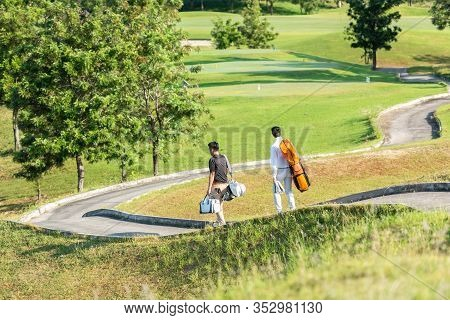 Group Golf Professional Golfer Asian Man Walking In Fairway With Bag Golf At Golf  Club.  Hobby In H